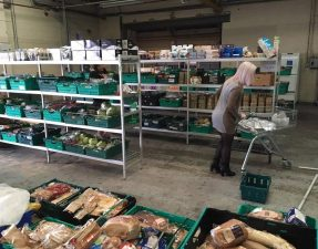 A shopper browses the shelves in the UK's first food waste supermarket The Real Junk Food Project
