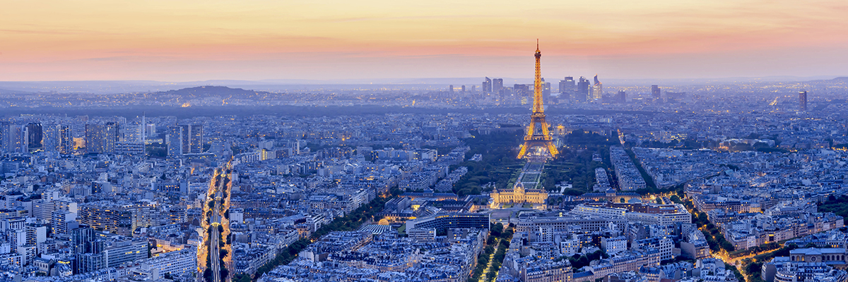 PARIS - JUNE 21: Eiffel Tower brightly illuminated at dusk on JUNE 21, 2014 in Paris. The Eiffel tower is the most visited monument of France.