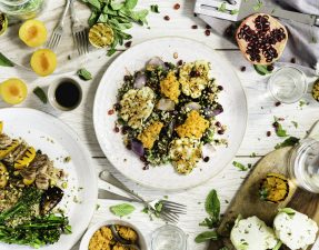 Cauliflower steaks, harissa hummus & walnuts